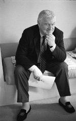 Frank Delaney, Irish writer sitting on a couch