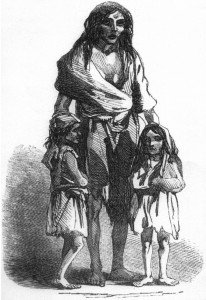 Black and white vintage image of a woman and her children at the time of the Irish famine