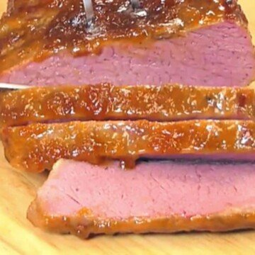 Slices of corned beef with an orange glaze