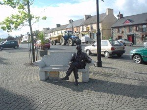 Statute of Percy French sitting on a bench