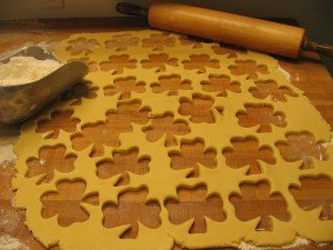 Rolled pastry dough with shamrock shapes cut out