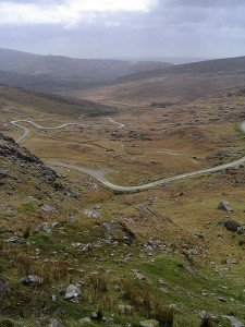 Winding Irish country road through a mountain pass between Cork and Kerry