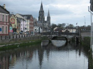 Arched bridge over the River Lee with a view of Saint Finbarres Cathedral