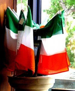Many Irish flags in one bowl on a window sill