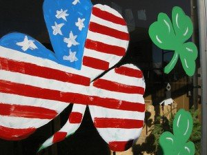 Shamrock painted on a shop window in the stars and strips of the American flag