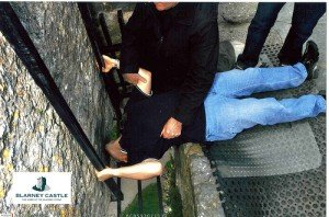 The position required to kiss the Blarney stone on top of a castle