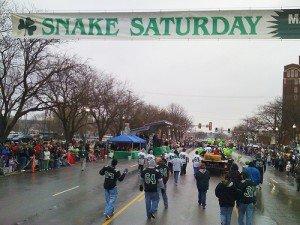A sign over the North Kansas City Saint Patrick's Day Parade saying Snake Saturday