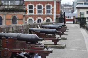 Cannons lined up on top of the walls around Derry city
