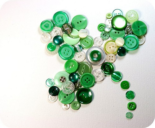 Shamrock artwork made with many green and white buttons