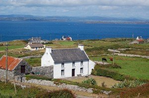 White farmhouse with stone walls on Cape Clear Island in County Cork