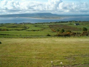 Green Irish fields looking over Lough Swilly in Ireland