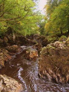 A brown colored river in County Donegal Ireland
