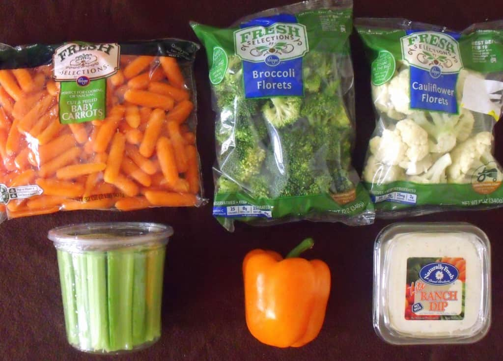 Carrots, broccoli, cauliflower, celery, orange pepper and ranch dressing on display