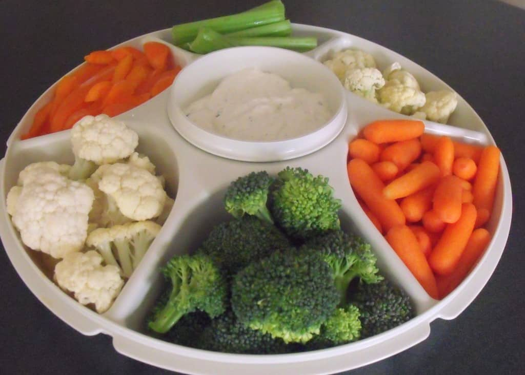 An Irish themed green, white and orange vegetable platter for Saint Patrick's Day