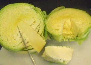 cutting the tough stalk out of a cabbage