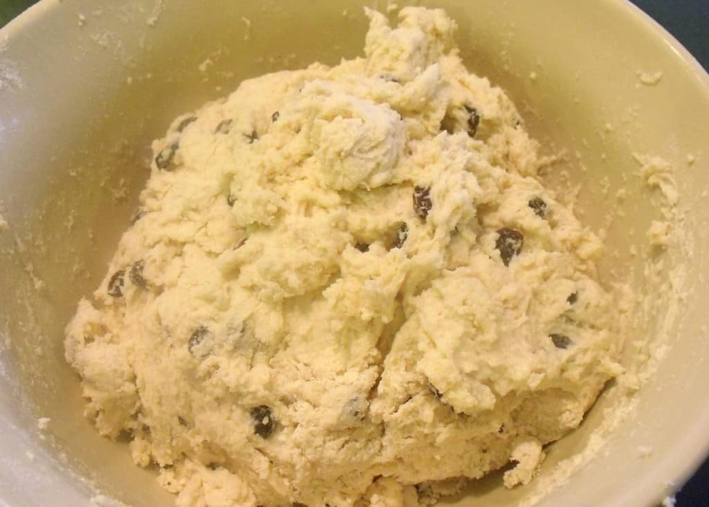 Forming a dough ball for Irish raisin soda bread in a bowl
