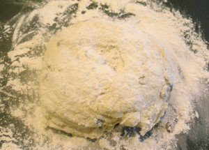 A dough ball of Irish soda bread on a floured surface for kneading