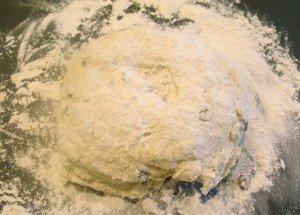 A dough ball of Irish soda bread on a floured surface for kneading