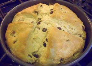Baked loaf of Irish Raisin Soda Bread with golden crust