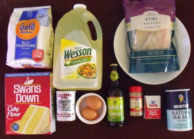 Ingredients for beer battered fish including flour, co, oil eggs, beer, baking powder and seasonings