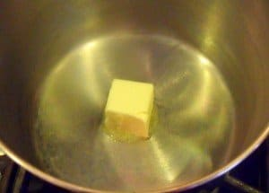 Melting butter in a pan before cooking mushy peas