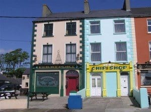 A yellow and blue front on an Irish chip shop