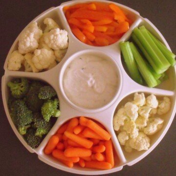 Carrots, broccoli, cauliflower, peppers and celery on a veggie tray with ranch dip