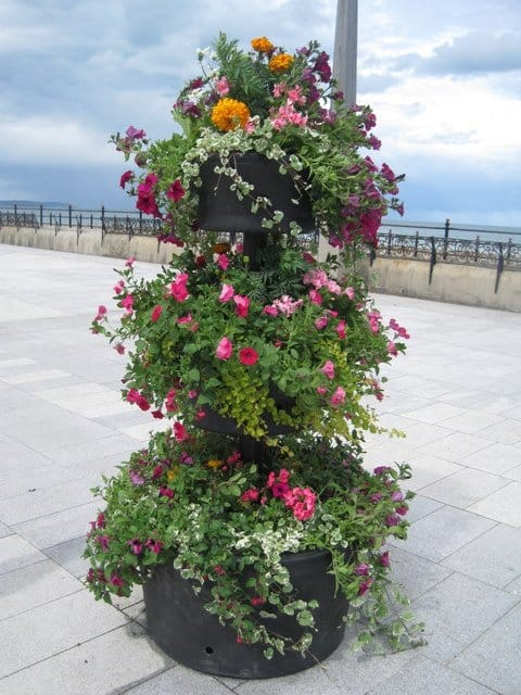 Three tiers of flowers in a flower display