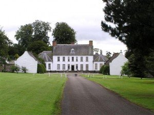 A large two storey white farmhouse in County Derry Ireland