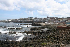 Waves by the rocky shore and promenade in Portstewart, County Derry, Northern Ireland