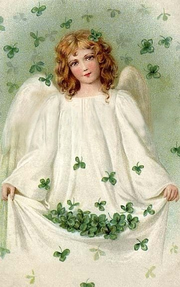 An angel holding shamrocks in her white gown