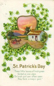 Victorian greeting card with a thatched cottage inside a shamrock frame