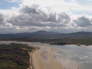 Looking down on Five Fingers Strand with a cloudy sky above
