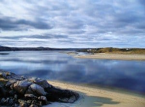 Gweedore Bay in County Donegal with the sky reflecting in the ocean water