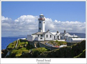 White lighthouse and surrounding buildings in Fanad County Donegal Ireland