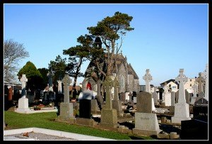 County Galway graveyard with many Celtic crosses over the graves