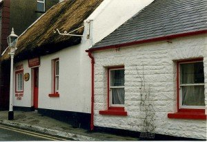 A thatched bar with red windows and door in Ballyshannon County Donegal