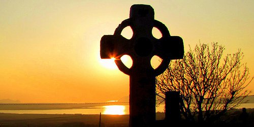 Sunset over a Celtic Cross in Ireland