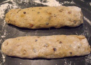 Two dough logs on a flour dusted surface