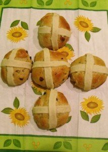 Five hot cross buns lined up in the shape of a cross