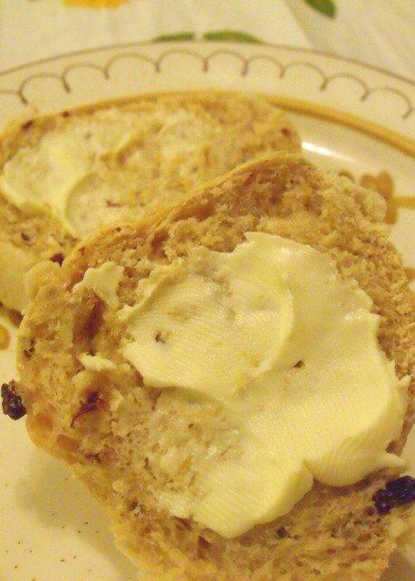 Butter on a half of a hot cross bun