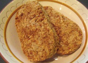 Two dry weetabix biscuits in a bowl