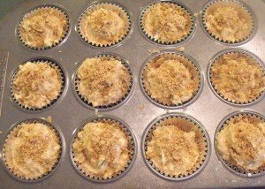 Sprinkling crumbled weetabix flakes on uncooked muffins