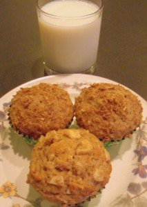 Three banana nut wholewheat muffins with a glass of milk