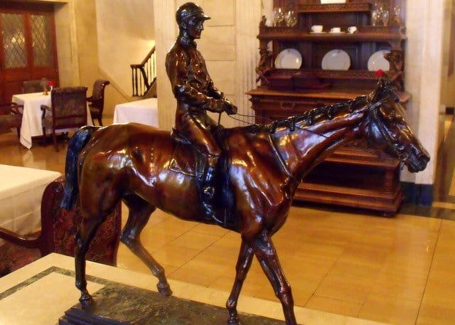 Wooden carving of a jockey on a horse at the Brown Hotel in Louisville