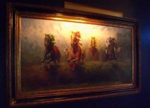 Oil Painting showing four horses jumping over a fence