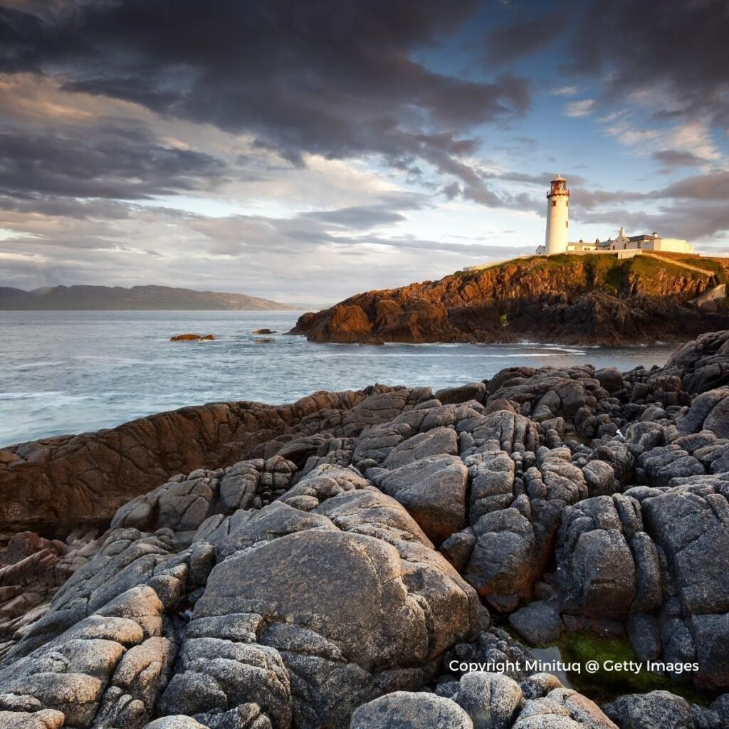Lighthouse on a rocky promontory