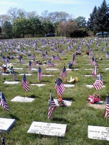 American graves of veterans decorated with US flags for Memorial Day
