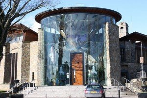 The glass and stone entrance to the Saint Patrick Centre in County Down