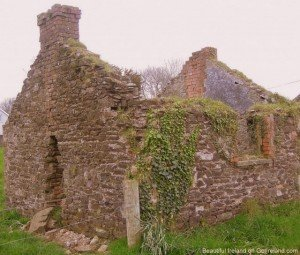 A roofless shell of a stone farmhouse in Ireland